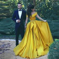 yellow wedding dress beauty and the beast disney themed wedding gold roses