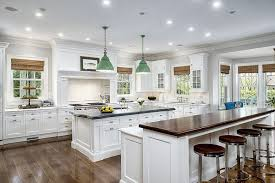 kitchens with large islands features two large islands hardwood flooring dma