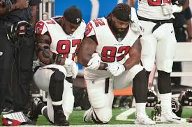 verify are nfl football players required to stand for the