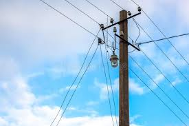 pillar with electric wires on a background of blue sky with clou