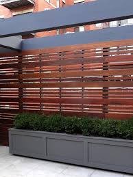 Types Of Garden Fencing A Chicago Rooftop Fence By Topiarius In A Horizontal Design Is