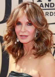 hair color women 50 years old jaclyn smith s feathered hairstyle jaclyn smith feathered