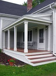 covered front porch plans front porch design and deck pictures i like the look of the skirt