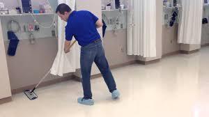 waxing a floor flat mop system