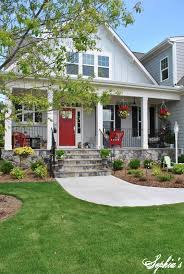 sophia u0027s farmhouse style front porch with pops of red doors
