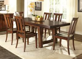 trestle table with iron support stretcher and turnbuckle details