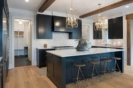 black island kitchen backless wood and brass swivel stools at black island