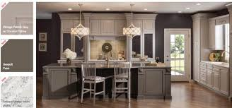 gray painted kitchen cabinets with warm floors and gold