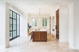 Herringbone Tile Floor Kitchen - walnut island kitchen with herringbone tile floor and off white