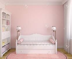 interior of toddler room with white furniture and pink wall