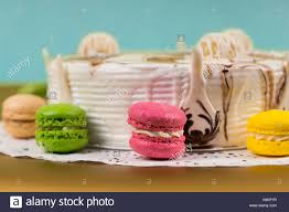 appetizing cake with different chocolate ornaments near macarons