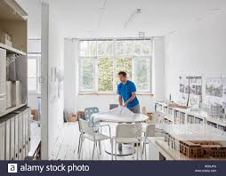 architectural plans a modern office a man looking at plans at a table architectural