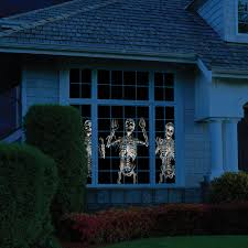 animated holiday scene projector brings halloween christmas to