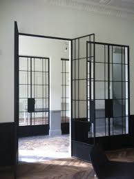 glass french doors masculine room with distressed chevron wood floors and rolled