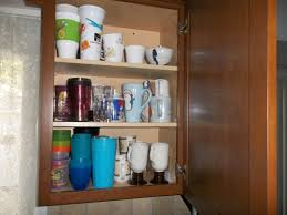 how do you arrange dishes in kitchen cabinets organize kitchen cabinets how we got rid of 99 dishes
