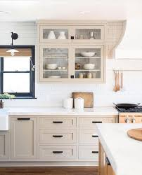 white kitchen cabinets with taupe backsplash pin by woods on for the home beige kitchen