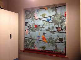 black out roman blind made using ikea bird print fabric and a red