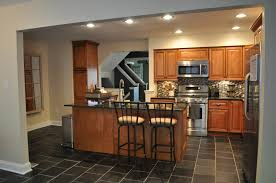 awesome brown wooden kitchen cabinet with iron stools as well as