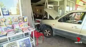 car crashes through packed manning cafe after accidentally pushing