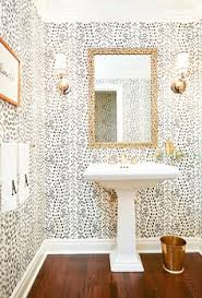 5 of the prettiest patterned powder rooms white wallpaper round