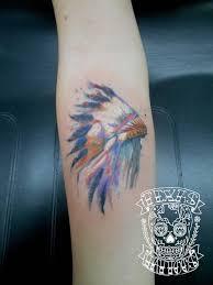indian headdress tattoo on ribs watercolor native american headdress done by josh at texas tattoos