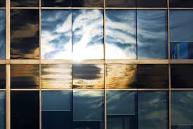 installing security window film to improve privacy and energy savings