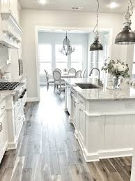hey friends here is a home tour with all my sources and paint white kitchen cabinets pendant lights and wood tile floor makes for a really gorgeous kitchen