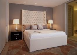 upholstered headboard king bedroom contemporary with accent wall
