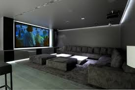 building a sectional sofa basement home theater with grey walls and sectional sofa