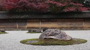 details of the beautiful rock garden at ryoan ji temple kyoto