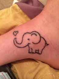 outline baby elephant tattoo on left ankle
