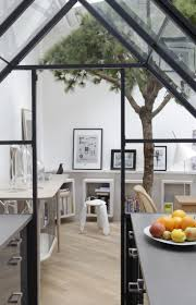 96 best kitchens images on pinterest kitchen kitchen ideas and home view out of a kitchen built in a greenhouse built in a loft with preserved pine tree and unusual wall shelves gregoire de lafforest voltaire kitchen