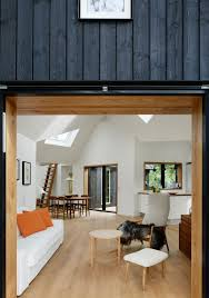 rustic village house integrating traditional danish elements by