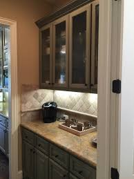 what color tile goes with brown cabinets before after a gold toned home gets a fresh new