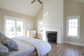 Master Bedroom Ceiling Fans by Cottage Master Bedroom With Ceiling Fan U0026 Hardwood Floors In Stone