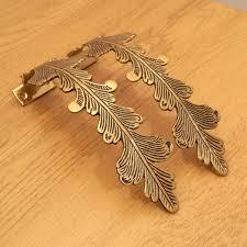 Umbra Curtain Holdbacks A Pair Of Brass Curtain Hold Backs Gold Colour Works Well