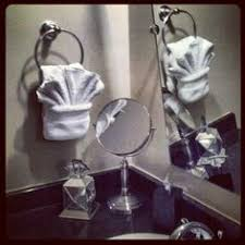 towel folding ideas for bathrooms fancy towel folding with dragonfly bling pinteres