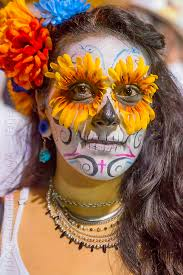 with sugar skull makeup and flower
