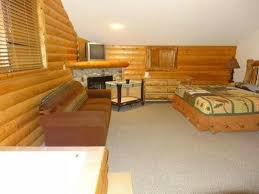 grizzly jacks grand bear resort wedding ceremony master bedroom upstairs has fireplace couch that folds out and