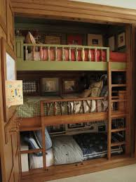 bedroom with wooden triple bunk bed space saver triple bunk bed