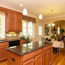 light brown kitchen cabinets with black appliances black and brown kitchen houzz
