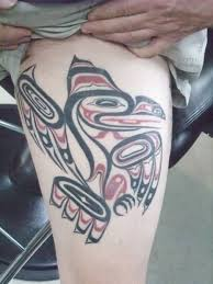 aboriginal tribal bird tattoo on thigh
