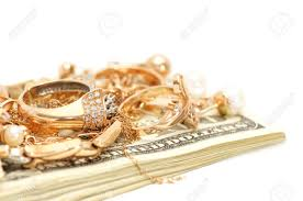 gold ornaments and dollars isolated on a white background stock