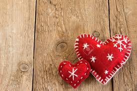 christmas concept decoration two red handmade hearts over