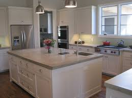 Grey Wood Floors Kitchen by White Island With Concrete Countertop Side By Side Refrigerator