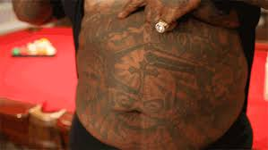 what rick ross u0027s belly tattoo actually says photos 101 1 the wiz