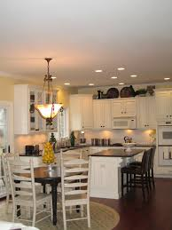 funky track lighting free kitchen with large island table and