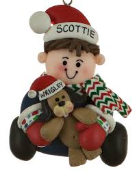 boy holding personalized ornament