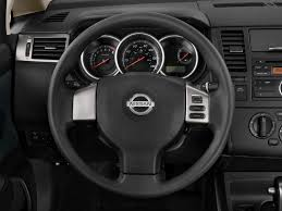 nissan versa sedan review 2011 nissan versa steering wheel interior photo automotive com