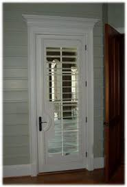 Shutter Interior Doors Interior View Of Plantation Shutters On A Glass Front Door The